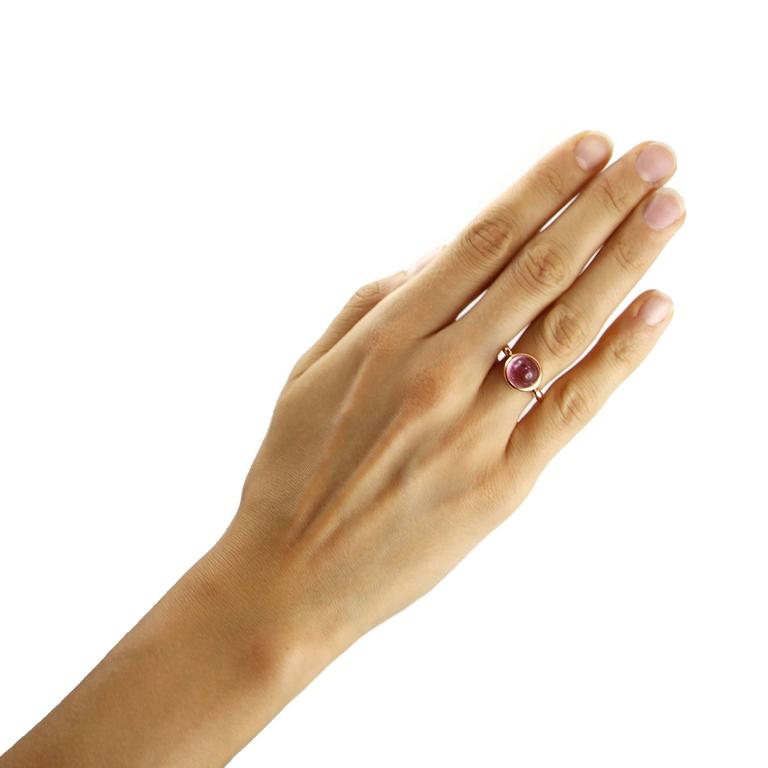 Jona design collection, hand crafted in Italy, 18 karat rose gold ring set with cabochon pink tourmaline weighing 7 carats. The bezel setting swivels in between the ends of the band. US size 6, EU size 12. It can be sized to any specification.