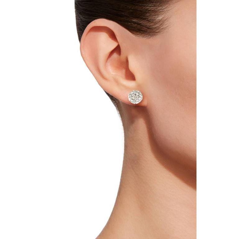 Jona design collection, hand crafted in Italy, 18 karat white gold diamond pavé ear studs set with 1.04 carats of white diamonds, F color, VVS1 clarity.  Dimensions: Diameter 0.32 in - 8mm  All Jona jewelry is new and has never been previously