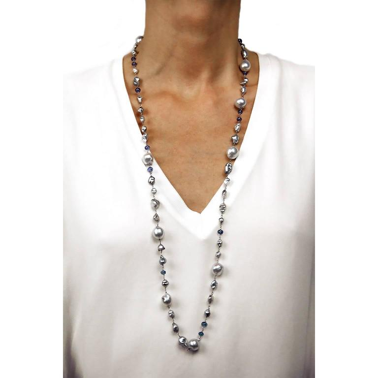 Jona design collection, hand crafted in Italy, 18 karat white gold, 35.43 in / 90 cm long sautoir necklace featuring 40 keshi grey Tahiti pearls, 9 baroque Tahiti grey pearls, alternating with 15 cabochon tanzanites.