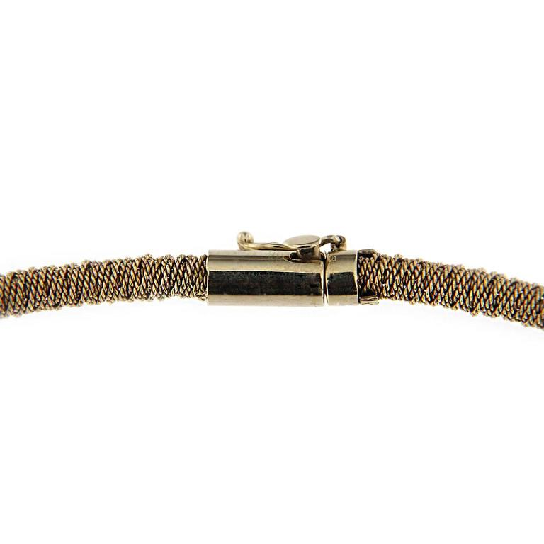 This flexible choker by Jona, hand crafted in Italy, is made by a twisted 18 Karat  white gold wire. All Jona jewelry is new and has never been previously owned or worn. Each item will arrive at your door beautifully gift wrapped in Jona boxes, put