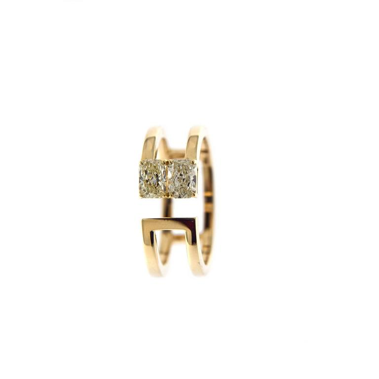 Jona design collection, hand crafted in Italy, 18 Karat yellow gold open band ring set with 2 radiant cut yellow diamonds weighing 0.83 carats in total, VS1 Clarity. US size 6.5 can be sized to any specification. All Jona jewelry is new and has