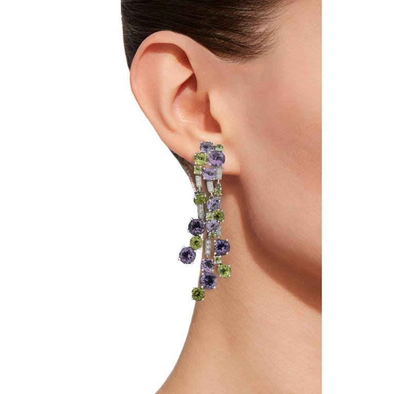 Jona design collection, hand crafted in Italy, chandelier clip earrings featuring 7.57 carats of amethysts, 5.34 carats of peridots and 0.37 carats of white diamonds.  All Jona jewelry is new and has never been previously owned or worn. Each item