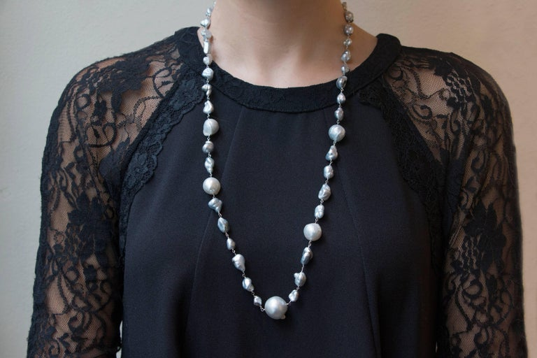 Jona design collection, hand crafted in Italy, 18 karat white gold necklace featuring 45 light grey baroque South Sea pearls weighing 43.01 carats.  Dimensions: 28.34 in. L x 0.69 in. W 72 cm. L x 1.7 cm. W  All Jona jewelry is new and has never