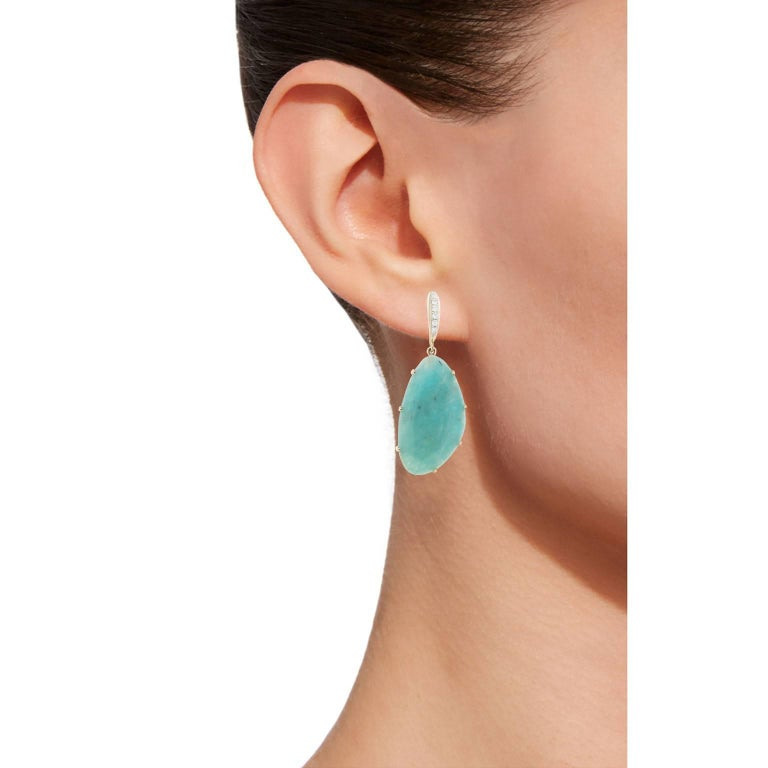 Jona design collection, hand crafted in Italy, 18 karat yellow gold pendant earrings set with two flat cut irregular shape Amazonite weighing 16.05 carats and 12 white diamonds weighing 0.11 carats. Dimensions: 1.6 in. H x 0.54 in. W x0.37 in. D -