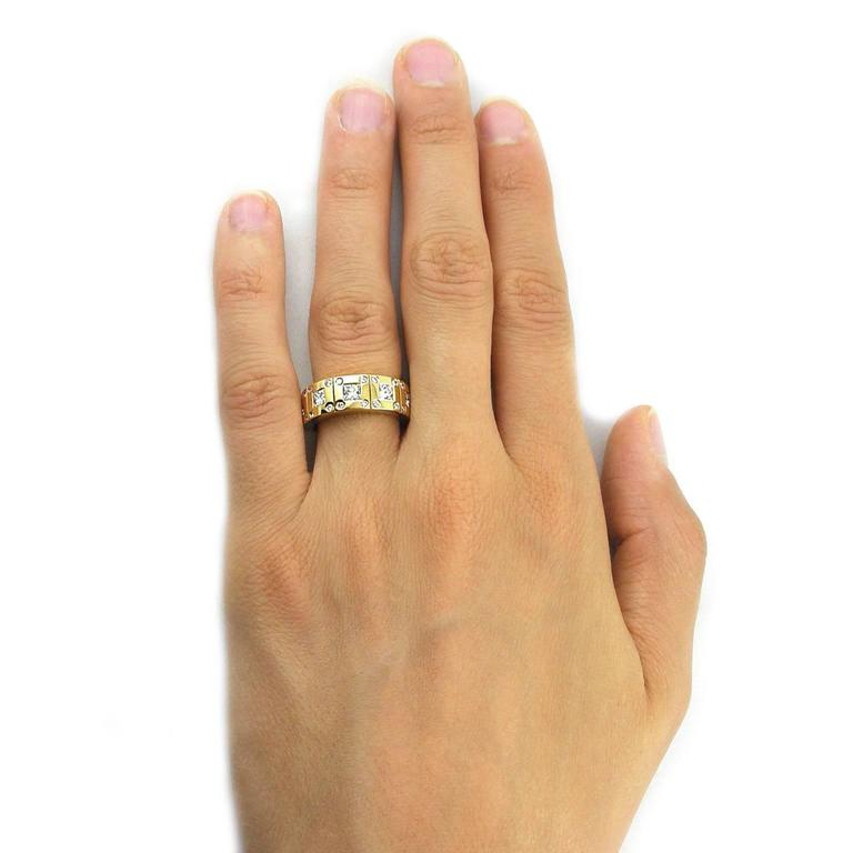 Jona design collection, hand crafted in Italy, 18 Karat yellow gold band ring set with 5 square cut white diamonds weighing 1.19 carats in total, G color, VVS2 clarity. US size 6.3 can be sized to any specification. All Jona jewelry is new and has