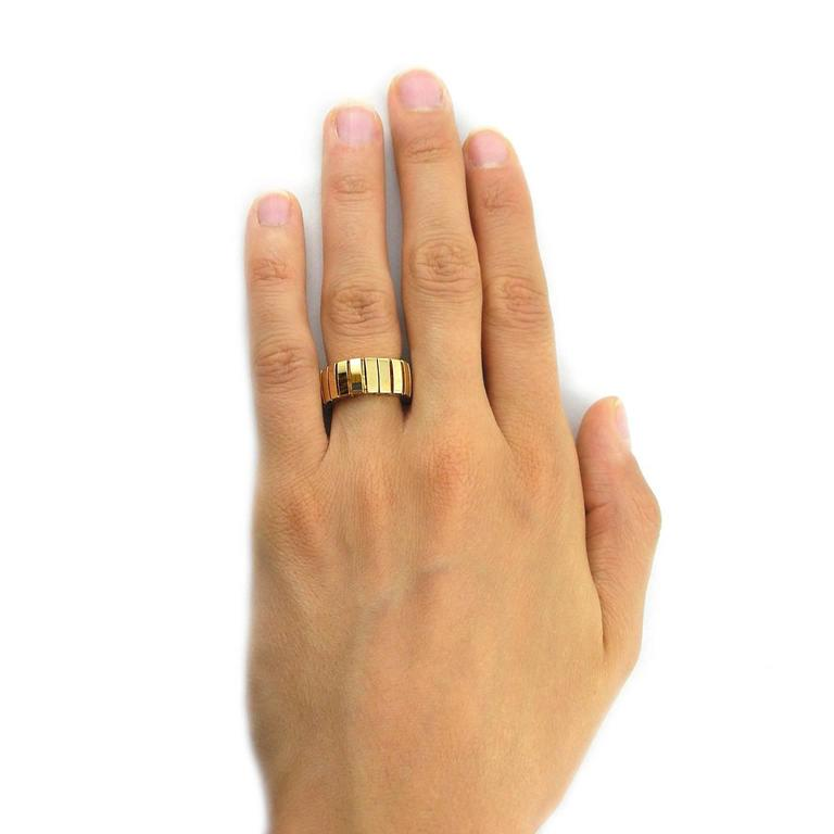 Jona design collection, hand crafted in Italy, 18 Karat yellow gold flexible band ring. US size 7 can be sized to any specification. All Jona jewelry is new and has never been previously owned or worn. Each item will arrive at your door beautifully