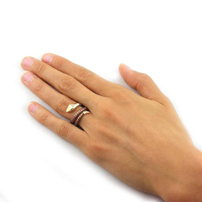 Jona design collection, flexible serpent ring, the coiled brown sterling silver body is linked to a 18 Karat rose gold tail and head, two brilliant cut white diamonds eyes. Size US 7.3, can be sized to any specification.  All Jona jewelry is new and
