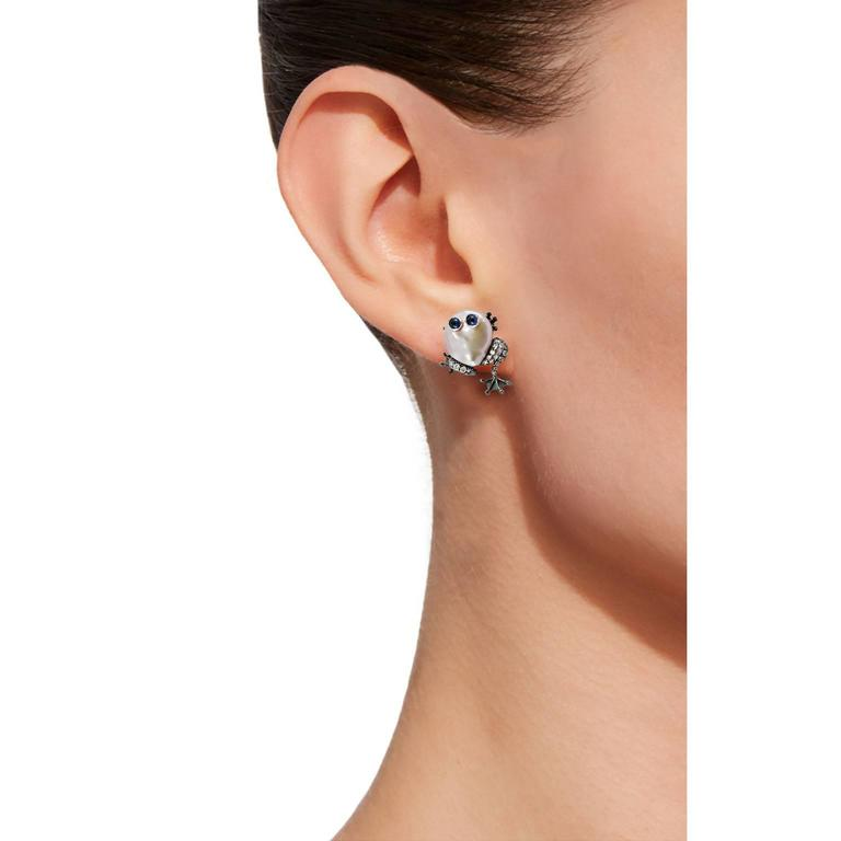 Jona design collection, hand crafted in Italy, 18 karat white gold frog clip-on earrings, showcasing two baroque pearls, with a diamond black rhodium set frame and four blue cabochon sapphires.  All of our jewelry is new and has never been