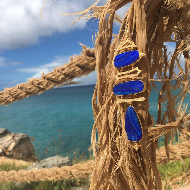 Vibrant blue Boulder Opal doublets are surrounded by 18kt Yellow gold and Diamonds in feminine and geometric designs.  Finished in Lauren Harper's signature matte gold, this necklace hangs on a 28 inch 18kt Gold chain.