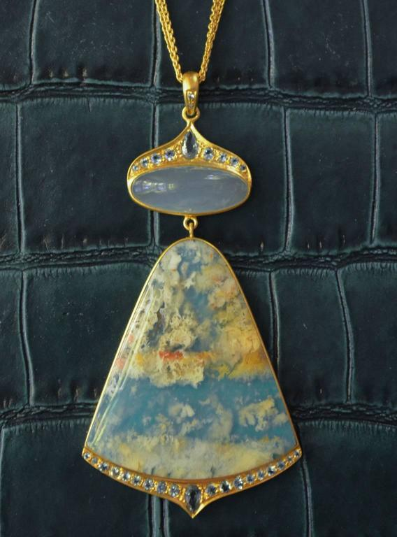 Truly a one of a kind, this pendant is beyond unique.  Lauren Harper has taken a translucent sea agate and set it on top of a turquoise composite, making a completely unique new stone that looks like clouds floating in the sky!  A cabachon