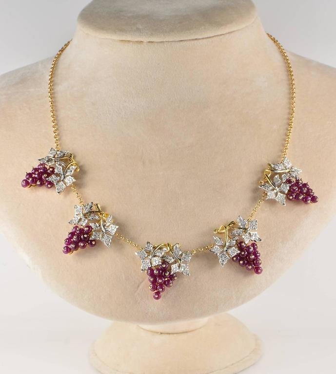 Sophisticate retro necklace from the 40's artful hand crafted of solid 18 KT   Exclusive design of delightful grapes made of Natural Rubies not treated beads and Diamonds  Leaf work is totally highlighted by 145 in number brilliant cut Diamonds for
