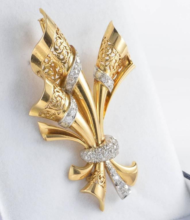 Substantially hand crafted of solid 18 KT rose gold and Platinum Designed as a beautiful bow bordered with finely made hand lace work fully enhanced by old mine and rose cut Diamonds (approx. 1.40 Ct rated G VS) set on Platinum. Perfect condition.