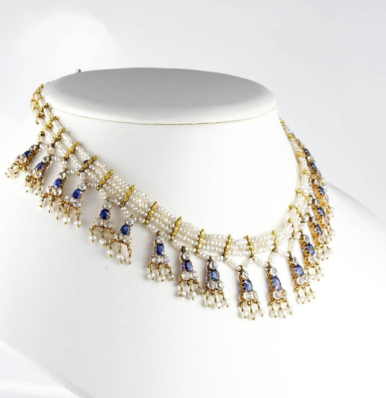 The Edwardian Elegance! Here is an exceptionally beautiful authentic 1900 necklace which positively exudes opulent Edwardian elegance Comprising three rows of dainty Natural seed Pearls inter spaced by 19 KT solid gold spacers, suspend a further