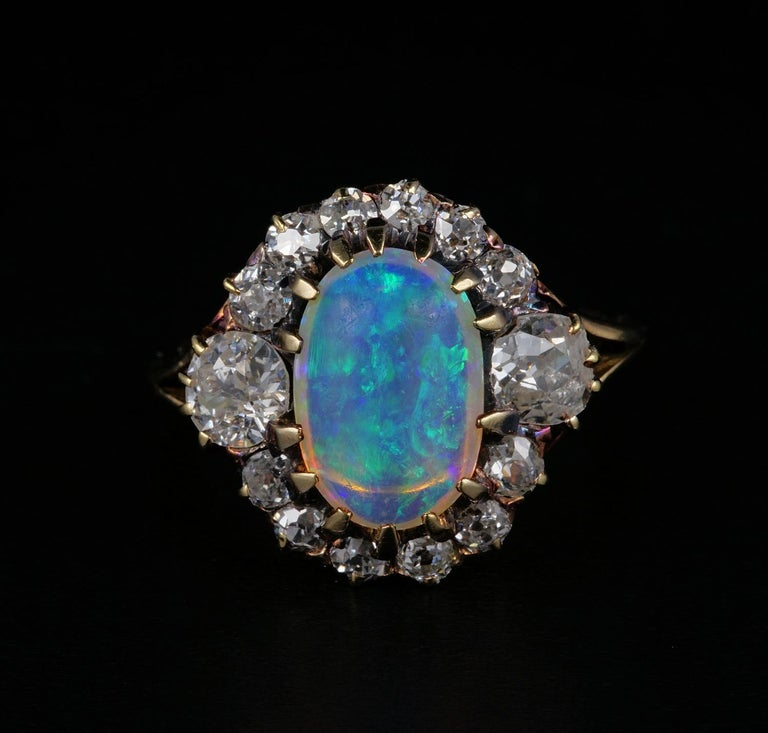 Scarce, hard to find, distinctive Opal ring from the Victorian period are sought after worldwide. This striking Victorian example is one of the more beautiful indeed. English origin, 1880 ca, it has it all! Charming oval design with two large side