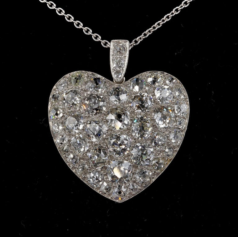 Spectacular Love Token Stunning find from the Edwardian period Authentic 1905 ca solid Platinum Crafted large Heart Pendant displaying a huge amount of old mine cut Diamonds all large and chunky in cut giving out a phenomenal amount of sparkle being