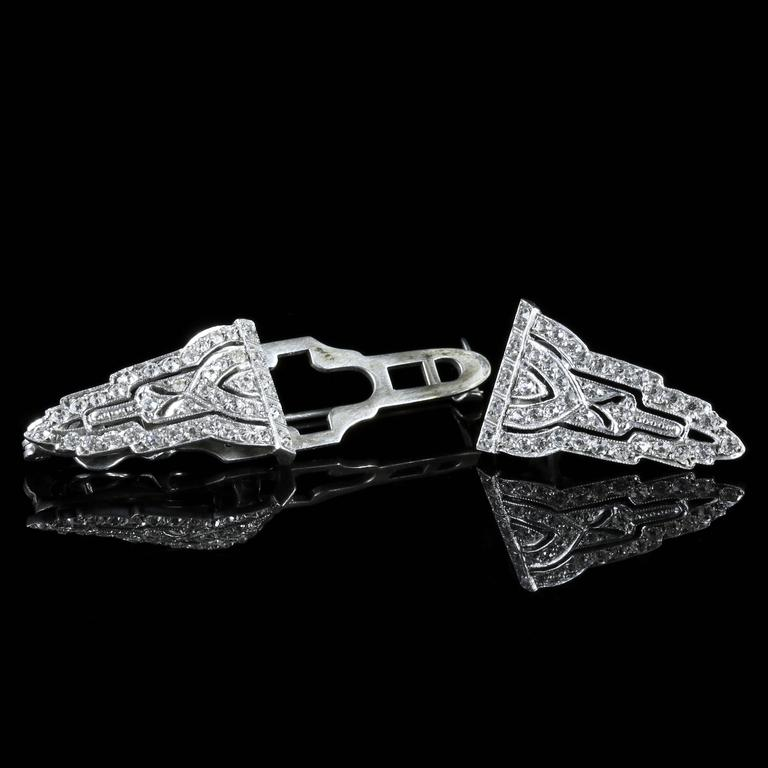 This beautiful Sterling Silver Art Deco double clip brooch is genuine 1920.   This unique Brooch has two detachable clips that will look fabulous on a lapel.  Each clip is adorned with white Paste Stones which sparkle as they catch the light.