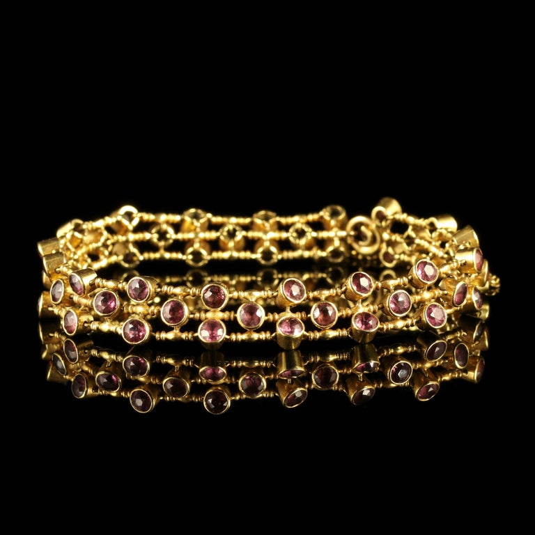 This fabulous Victorian Almandine Garnet bracelet is set in solid 18ct Yellow Gold.  Genuine Victorian, Circa 1900.   The bracelet is set with the most beautiful Almandine Garnets which are collet set around the gallery.  Almandine Garnets have a
