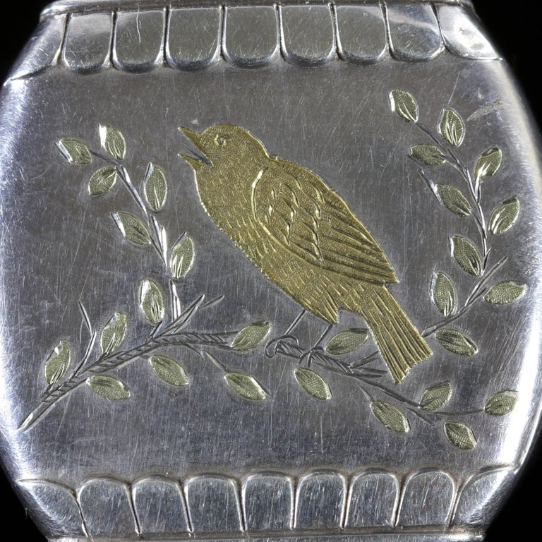 This fabulous Victorian Sterling Silver and Gold locket is hallmarked Birmingham 1876.  A lovely 18ct Gold bird sits in the centre on a branch tweeting his heart out.  Birds are a symbol of love, fun and affection during the Victorian Era.  A lovely