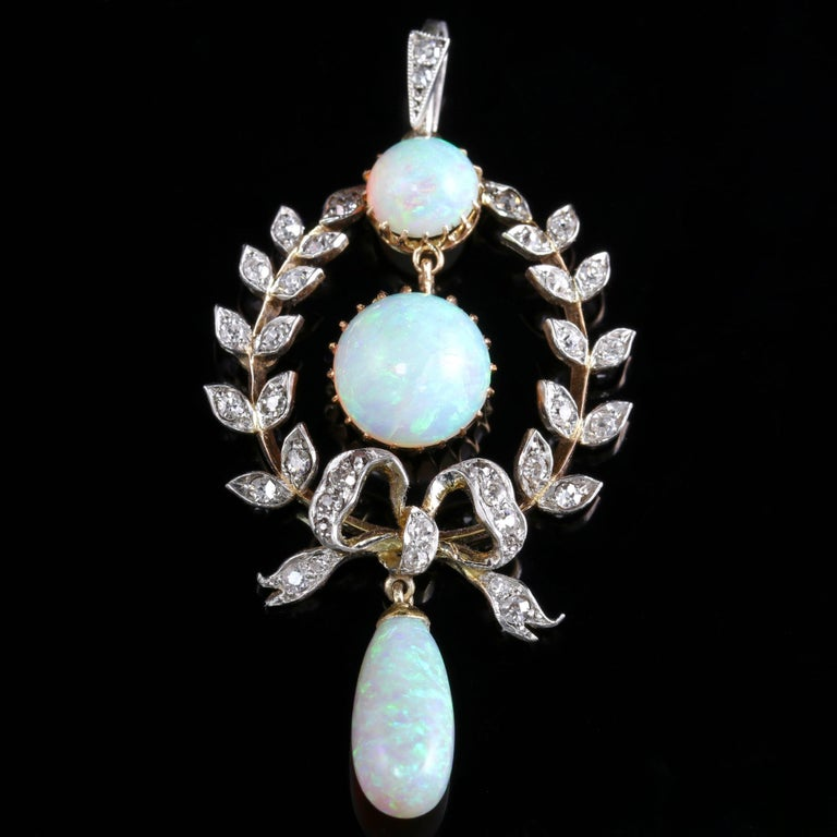 To read more please click continue reading below-  This fabulous Edwardian Opal and Diamond pendant is Circa 1910.  The central Opal is 3.5ct alone with a 1ct Opal at the top of the pendant and  a 2.80ct Opal dropper.  The lovely natural Opal is a