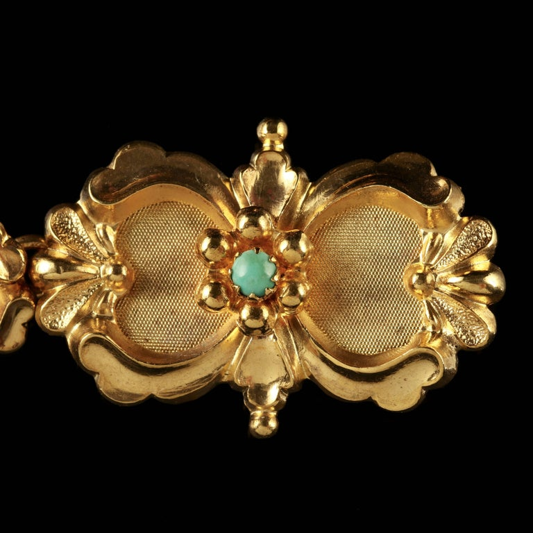 To read more please click continue reading below-  This fabulous antique Turquoise bracelet is set with beautiful Victorian workmanship from the 1880s.  Nine fabulous Turquoise stones adorn each link of this lovely bracelet including the large