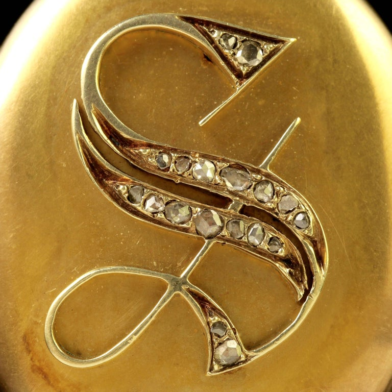 To read more please click continue reading below-  This fabulous antique 18ct Yellow Gold Victorian locket and chain is Circa 1900.  Old rose cut Diamonds adorn the initial ' S ' which is displayed in the centre of the locket.   A rose cut Diamond