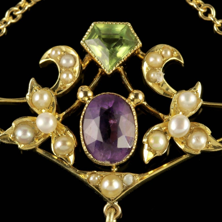 To read more please click continue reading below-  This fabulous antique Victorian 15ct Yellow Gold Suffragette pendant is Circa 1900.  Suffragettes liked to be depicted as feminine, their jewellery popularly consisted of Violet Green and White