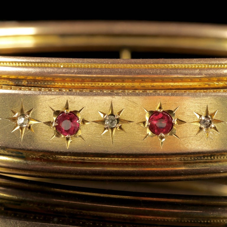 To read more please click continue reading below-  This beautiful antique Victorian 9ct Yellow Gold Ruby and Diamond bangle is Circa 1900.   The bangle is adorned with four Star set Rubies across the front gallery that are 0.10ct each, complimented