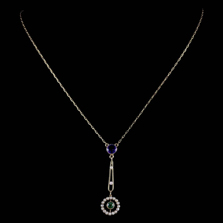 To read more please click continue reading below-  This beautiful antique Victorian 15ct Yellow Gold pendant necklace was made representing the Suffragette movement, Circa 1900.   Suffragettes liked to be depicted as feminine, their jewellery