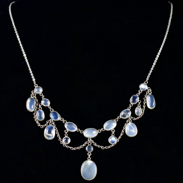 This glowing Victorian garland necklace is set in Silver, Circa 1880.  The necklace boasts wonderful Moonstones which hang beautifully.  The Moonstones have a ghostly hue and an excellent blue schiller.  The beautiful Moonstone has a lovely ghostly
