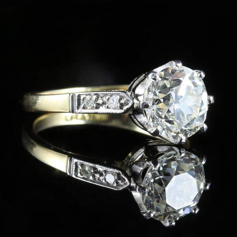 This beautiful Antique Edwardian 18ct yellow gold and platinum ring boasts a stunning 2.03ct Diamond in the centre that has been weighed.   It is Circa 1915   An additional 0.10ct of Diamonds sits on each shoulder, giving a total of 2.23ct.   The