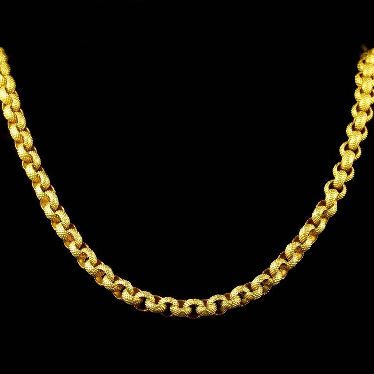 This fabulous long Georgian chain is 18th Century - Circa 1780.  Absolutely breath-taking in workmanship, each link is hand made leading to an original barrel clasp.  Steeped in English History, purchased in London.  The necklace is 18ct gold on