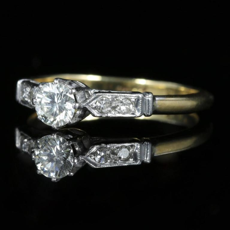 This stunning Antique 18ct yellow Gold and Platinum Diamond solitaire ring is beautiful.  Circa 1915 a lovely Antique Edwardian Victorian Diamond ring.  It is hallmarked 18ct and Plat  This lovely ring is set with an approx. of 0.45ct of Diamonds in