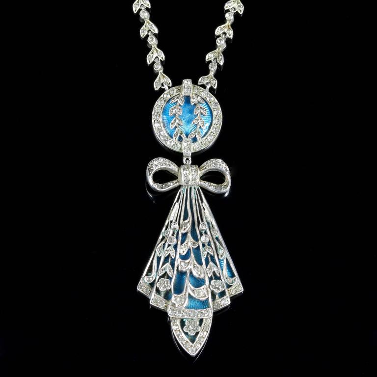 This very beautiful genuine Art Deco Sterling Silver necklace is set with beautiful blue enamel workmanship and Marcasite's.  The bright turquoise enamelling colour strikes through the Silver workmanship, with a central Marcasite bow and deco