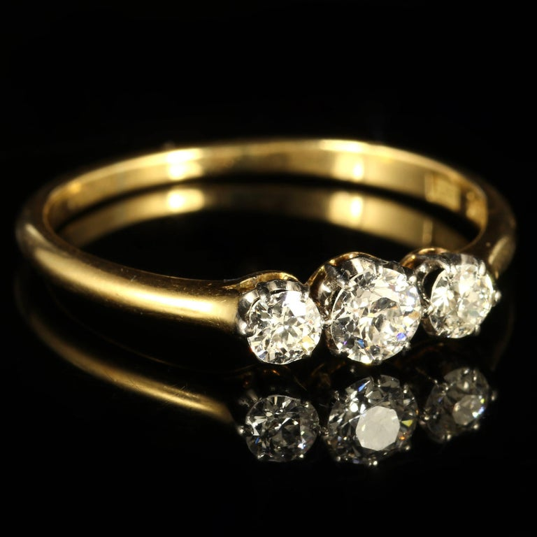 This fabulous18ct Yellow Gold and Platinumgenuine Edwardian ring is set with three superb clarity and coloured Diamonds - Circa 1910.  Each Diamond is SI 1 H in colour.  The sparkling centre Diamond is approx. 0.23ct with 0.14ct each side,