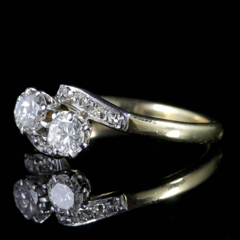 To read more please click continue reading below-  This genuine Antique Edwardian 18ct Gold and Platinum double twist ring is Circa 1910.  Two lovely old cut Diamonds sit in the central gallery with smaller Diamonds chasing down each shoulder.