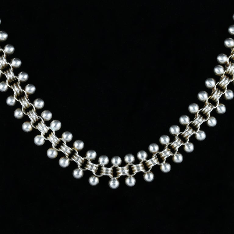 For more details please click continue reading down below..  This fabulous Sterling Silver Victorian necklace collar is Circa 1880  The collar is set with beautiful triple link inner links and Silver balls on each side of the gallery  It looks