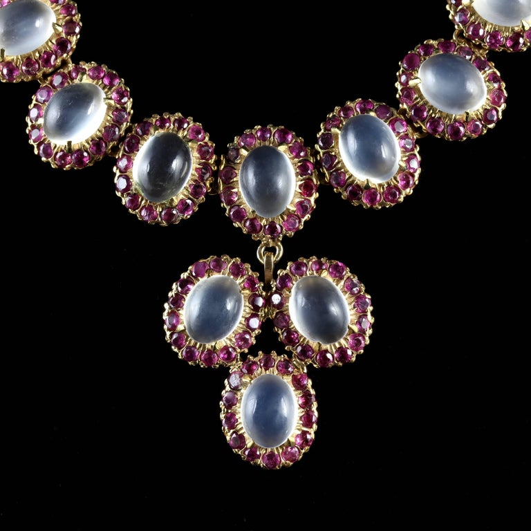 This fabulous 18ct Gold on Silver Ruby and Moonstone necklace is spectacular, Circa 1900.  Set with the most beautiful glowing Moonstones which have a blue schiller.  A halo of Rubies chase around each moonstone which compliments them superbly.  The