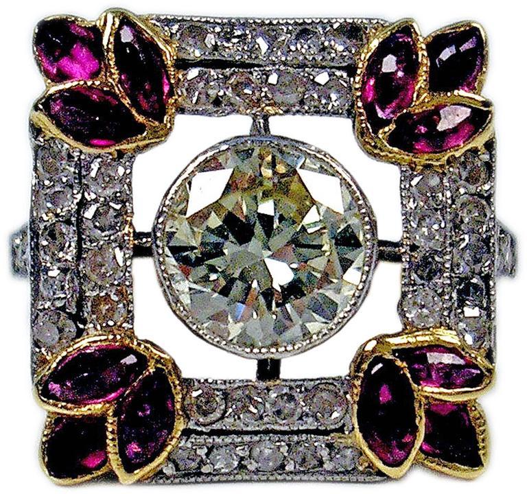 1900s Austria Art Nouveau 1.25 Carats Diamonds Rubies Silver Gold Cluster Ring