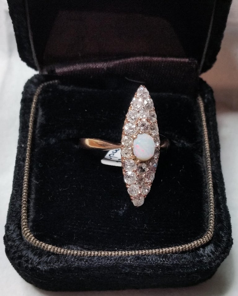 Golden Art Nouveau Ring of most elegant appearance with many diamonds and gemstone (= opal) in middle area:    ROSE GOLD  (14 ct  /  585)  /  DIAMONDS  (VINTAGE CUTS  / 1.5 Carat)    Art Nouveau ring of finest quality:  This ring covered with many