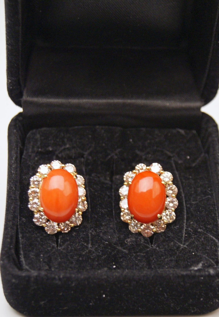Stunning Viennese Pair of Golden Cluster Earrings: There is a large oval coral attached to middle area of each earring / the coral is surrounded by a superb ring consisting of finest diamonds having weight of FOUR CARATS IN TOTAL.  These earrings