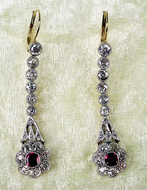 Golden art nouveau pair of marvellous eardrops of highest value with many diamonds (vintage cuts) as well as with rubies.