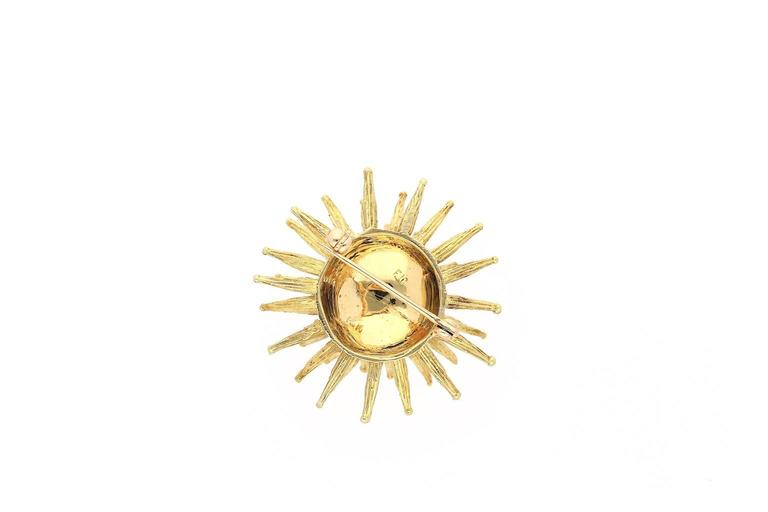 Set in 18k Yellow Gold.  Signed Tiffany & Co.  Centering a Round-Brilliant cut Diamond weighing 0.10 carats.