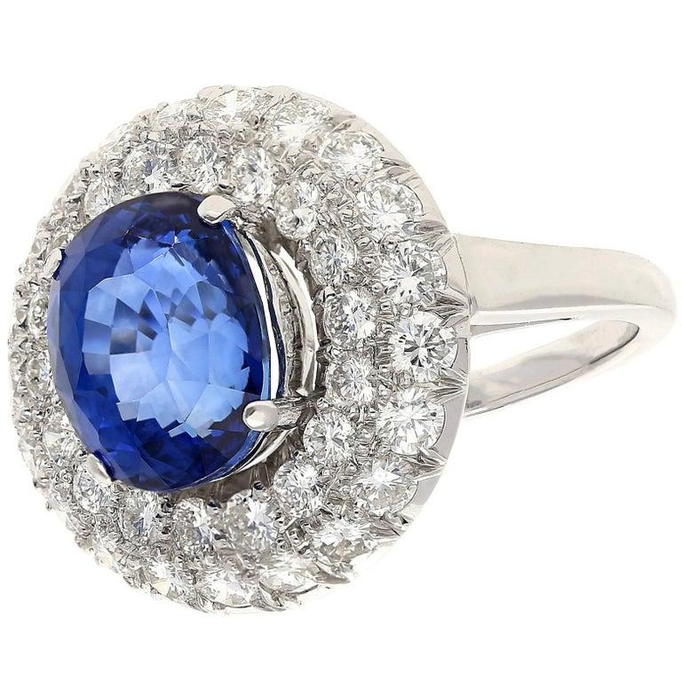 6.02 Carat Oval Cut Ceylon Sapphire Diamond Platinum Cluster Ring