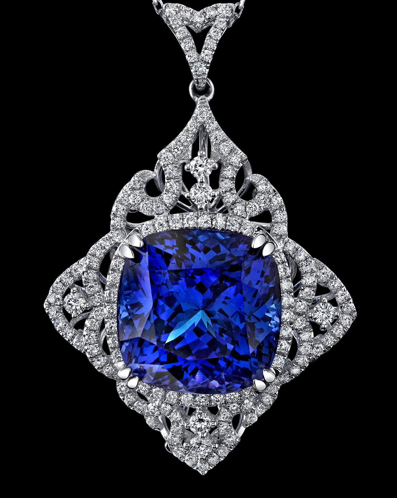 Featuring a Beautiful Square Cushion-cut Tanzanite; 17.5mm X 17.5mm; approx weight: 29.51ct; surrounded by round-cut Diamonds; approx. 1.924tctwt; hand crafted in 18K White Gold. Classic and Timeless!
