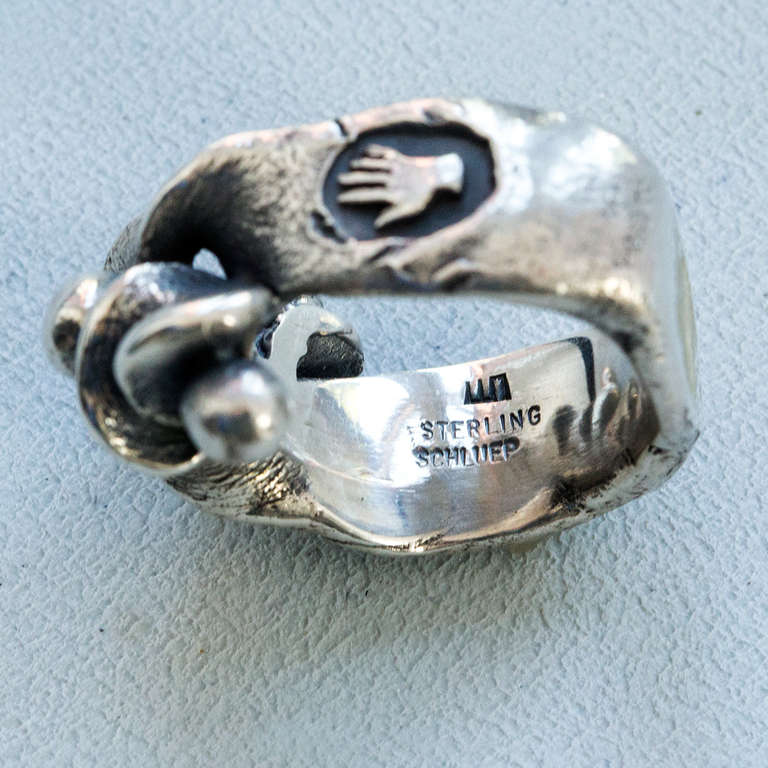 Walter Schluep Abstract Twist design Ring, inter spaced with three balls; all handmade and hand hammered in Sterling Silver; note the hand and stylized flower on the sides of the shank; Signed: SCHLUEP STERLING and WS his trademark signature. Artist