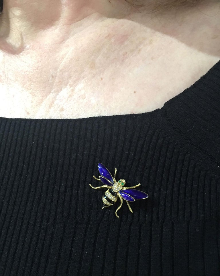 Delightful Bumble Bee Insect pin, blue enamel wings and black enamel torso, pave set diamond body and bezel set emeralds in eyes.  Chic and Timeless!