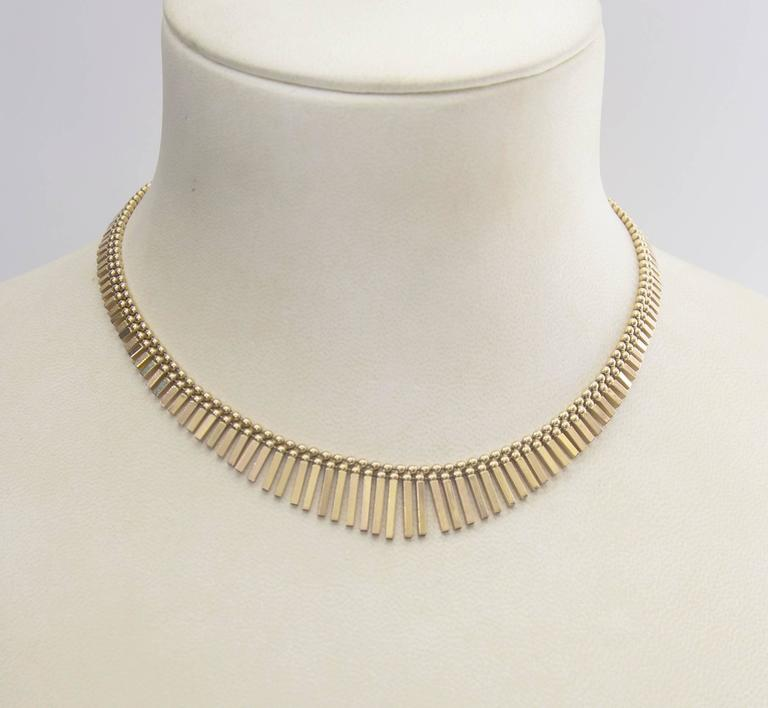 Feel like an Egyptian goddess with this 18k gold Cleopatra style tapered necklace; graduated flat bars define the beauty of this lovely necklace, hand crafted in 18k gold, secure invisible insertion clasp with a figure 8 safety. Hallmarked 18K 750