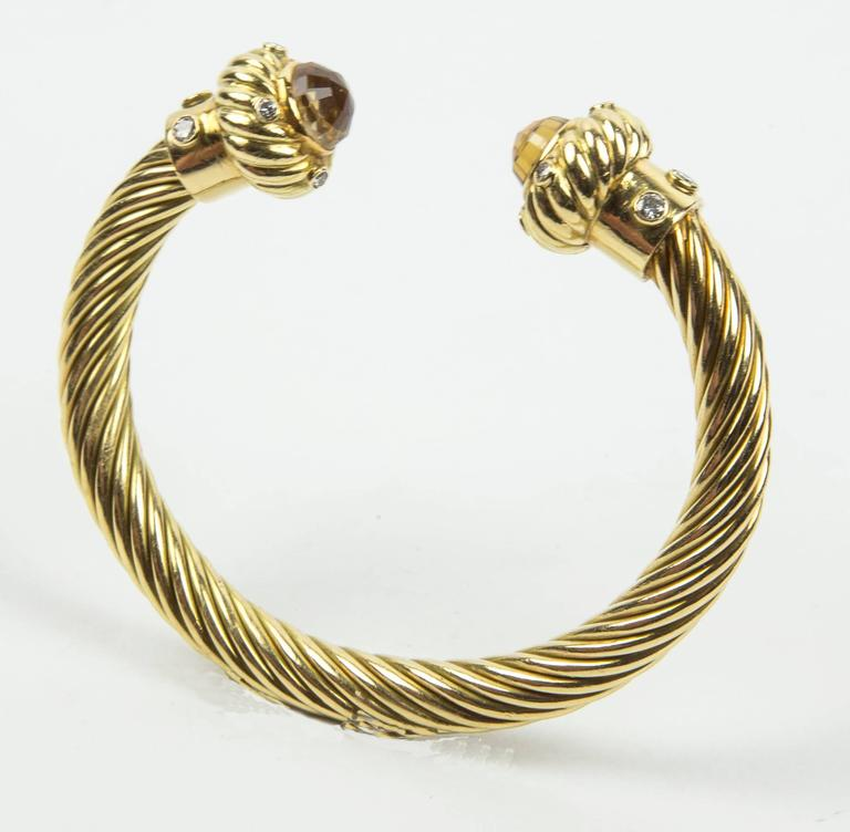 Stunning! 18K Yellow Gold Beautifully designed Braided Open Cuff Bangle Bracelet; ends completed with facet Citrine and Diamonds complementing the richly textured finish of this open bangle. 8 round and 6 brilliant cut diamonds approx.48ct; total