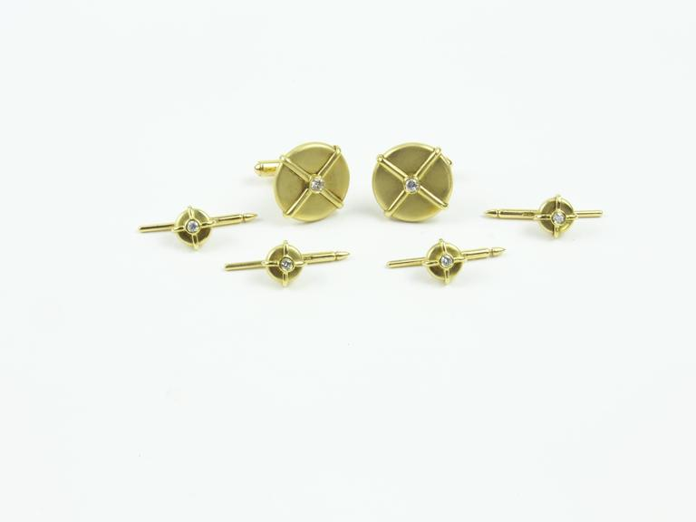 Classic Button Dress Set comprising a Pair of Cuff links and four matching Shirt Studs, with crisscross thread details, centers set with Diamonds; crafted in 18k yellow gold. For that Special Man in your life, including You!