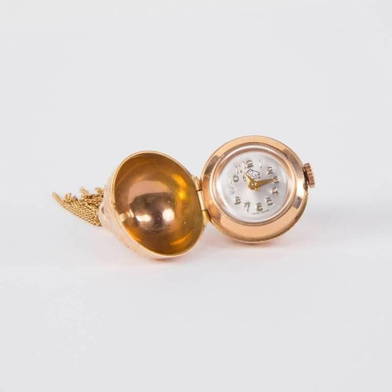 "Beautiful Modernist Pendant Ball Watch suspending multi-stand tassel; exquisitely made Swiss made by the fine jeweler Philly; overall Body is gold with beautifully worked engraved designs; 17 jewel Swiss manual wind movement. 2.25"" long x .75"""